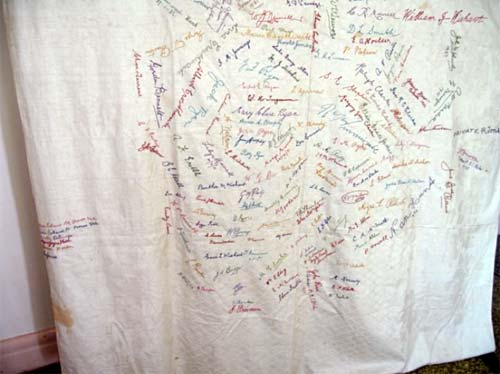 table cloth with embroidered signatures of townsfolk